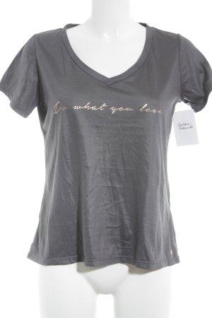 Tchibo / TCM T-Shirt grau-bronzefarben Schriftzug gedruckt Glanz-Optik
