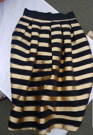 Falda circular negro-color oro