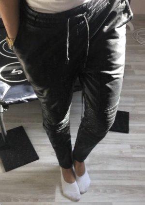 Tigha Pantalón abombado negro Cuero