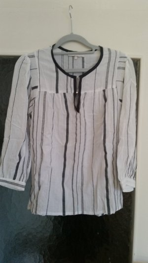 Tolle Bluse von Newlily Paris mit gestickten Streifen.