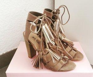 Tolle hohe Sandalen mit Fransen