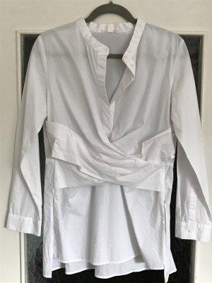 Tolle, kaum getragene weiße Bluse von COS mit schönem Bindedetail vorne. Schlitze an beiden Seiten. Reißverschluss links.