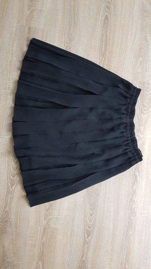 Jupe à plis noir