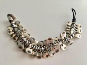 Ornamento braccia argento-marrone scuro