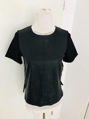 Tolles Oberteil in schwarz Gr S vorne mit Lederimitat neuwertig