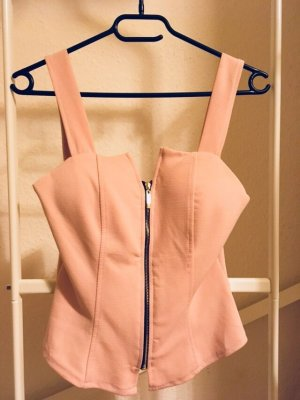 Top cut-out color oro rosa