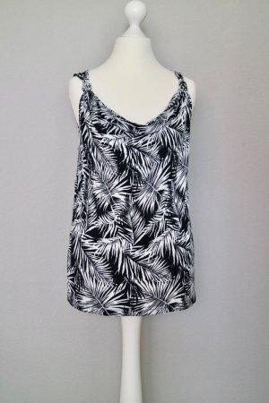 Top mit Wasserfallkragen und exotischem Muster schwarz/weiß