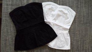 Tops mit Schößchen in Schwarz und Weiß