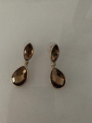 Clou d'oreille doré-bronze