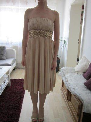 Trägerloses goldenes Kleid mit Strasssteinen