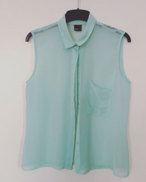 Transparente ärmellose Bluse