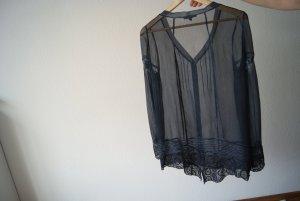 transparente blaue Bluse