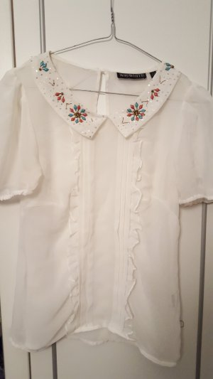 Transparente Bluse mit Rüschen und Perlen