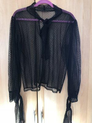 Transparente schwarze Bluse