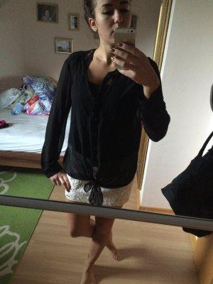 Transparente schwarze Bluse mit Knoten
