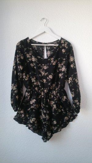 Traumhaft schöner schwarzer Playsuit / Jumpsuit / Einteiler mit Volants und floralem Muster tailliert