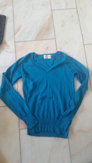 Türkiser Pullover mit V-Ausschnitt
