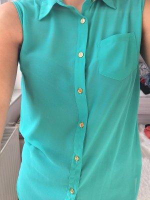 türkisfarbene Bluse mit Knöpfen