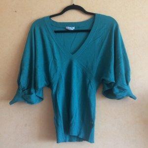 türkisgrüner Pullover