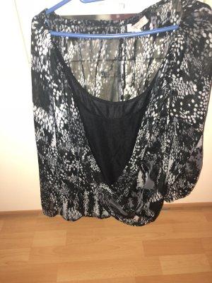 Blusa cruzada negro-color plata