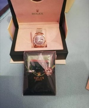 Rolex Watch With Metal Strap multicolored