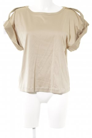Unger Camiseta color oro-beige estilo imperio