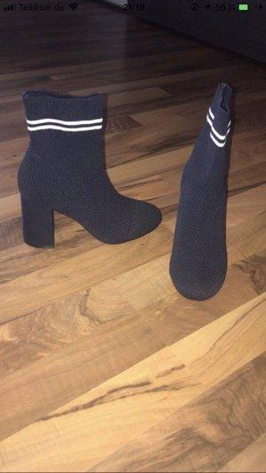 Korte laarzen donkerblauw-wit