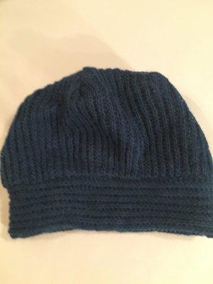 Chapeau en tricot bleu pétrole laine