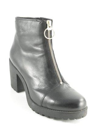 Vagabond Reißverschluss-Stiefeletten schwarz-goldfarben Street-Fashion-Look