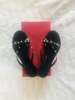 C. Valentino Flip-Flop Sandals black