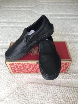 Vans black leather slip ones