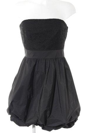 Vera Mont vestido de globo negro elegante