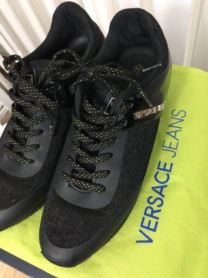 Versace Sneaker nero-oro