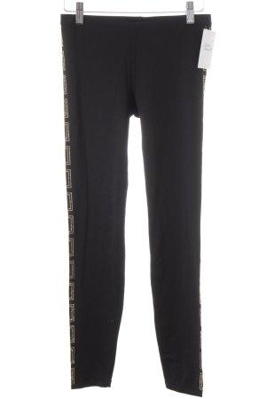 Versace for H&M Leggings negro-color oro estilo deportivo