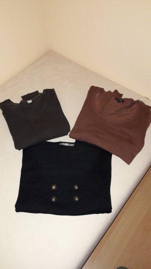verschiedene Pullover und Shirts