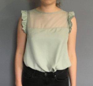 Verspielte Bluse in Pastellgrün