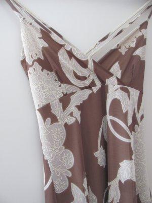 Verspieltes Kleid mit Mustern und überkreutzten Trägern