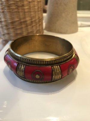 Bangle dark red-bronze-colored