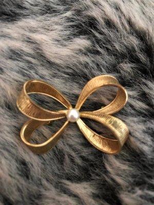Spilla oro-crema Metallo