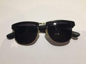 Linda farrow luxe Zonnebril zwart-goud kunststof