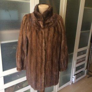 Abrigo de piel marrón oscuro Piel