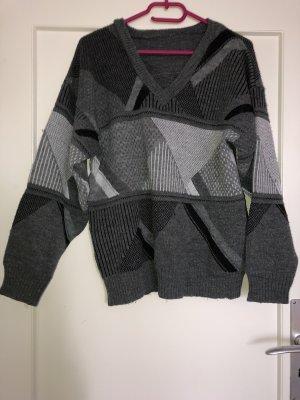 Pull oversize noir-gris
