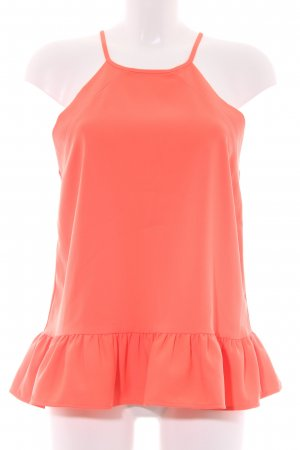 Top con balze arancio neon look retrò