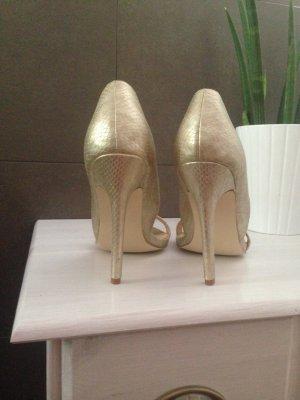 Wahnsinns-High-Heels in Gold
