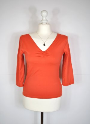 Weiches Shirt mit dreiviertel Arm und V-Ausschnitt im kräftigen Orange