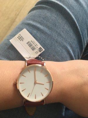 Weinrote Uhr mit rosé-goldenem Uhrwerk