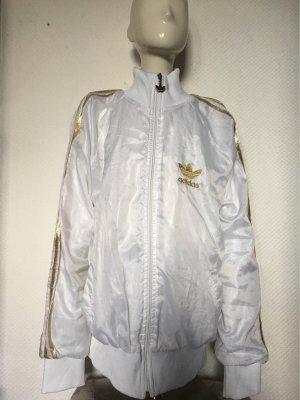 Adidas Originals Cortaviento blanco-color oro