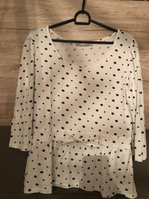 Weiß-schwarz gepunktetes Shirt mit Schößchen