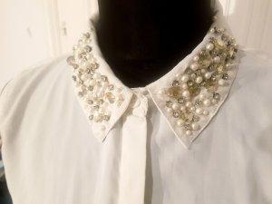 weiße ärmellose Bluse mit Statement Kragen