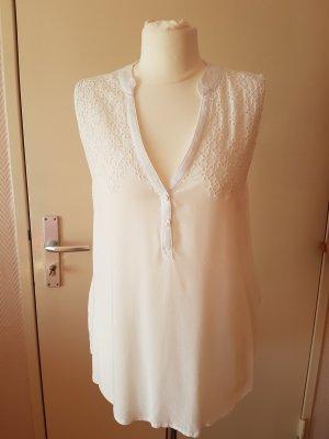 Weiße ärmellose Bluse mit V-Schnitt